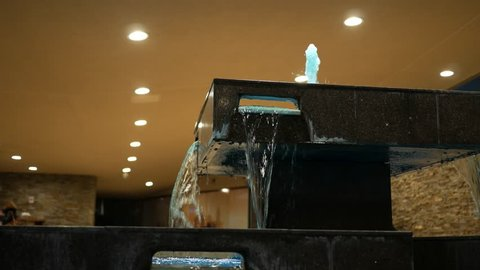 Modern luxury water fountain at hotel entrance