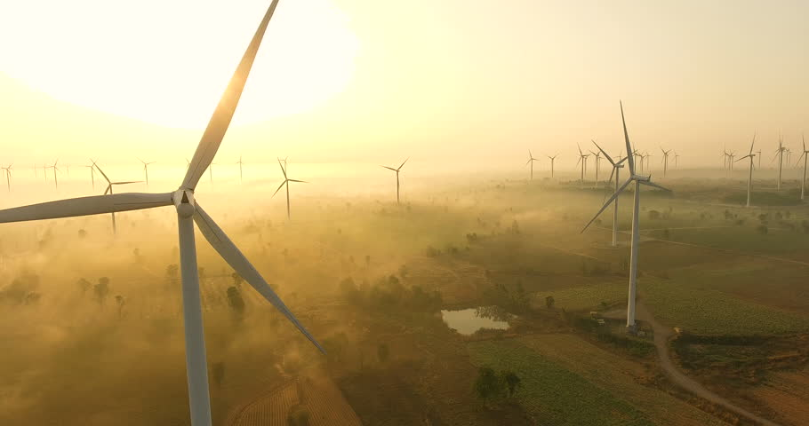 Aerial view of Wind turbines Energy Production- 4k aerial shot on sunset. 4k drone footage turbines at sunrise with clouds | Shutterstock HD Video #1019634475