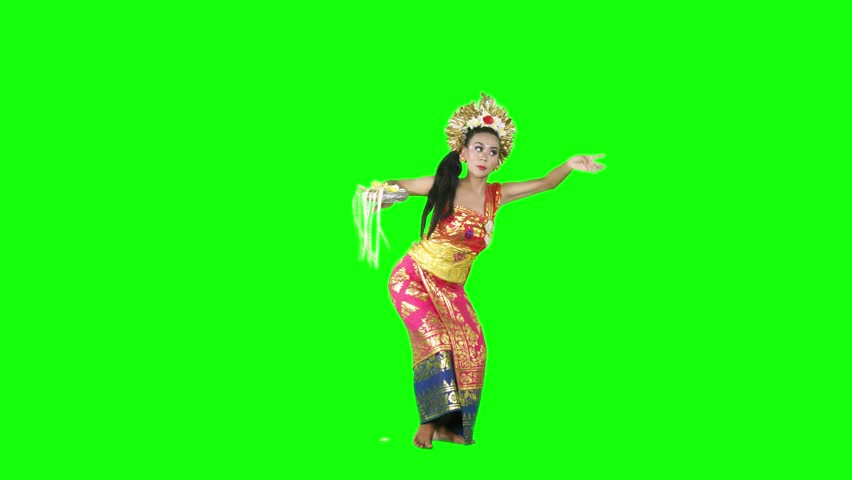Female traditional balinese dancer dancing in the studio with traditional costume. Shot in 4k resolution with green screen background | Shutterstock HD Video #1019636935
