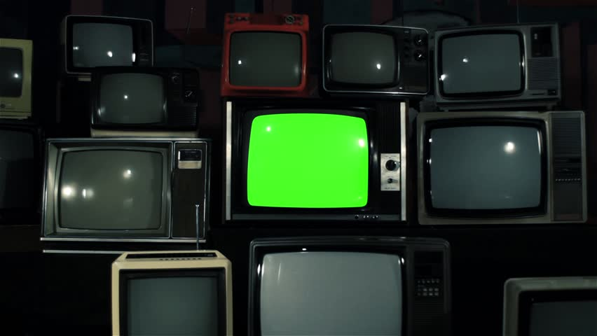"80s TV Green Screen with Many 80s Tvs. Dolly In. Iron Tone. Ready to Replace Green Screen With any Footage or Picture you Want. You Can Do it With ""Keying"" (Chroma Key) Effect. 