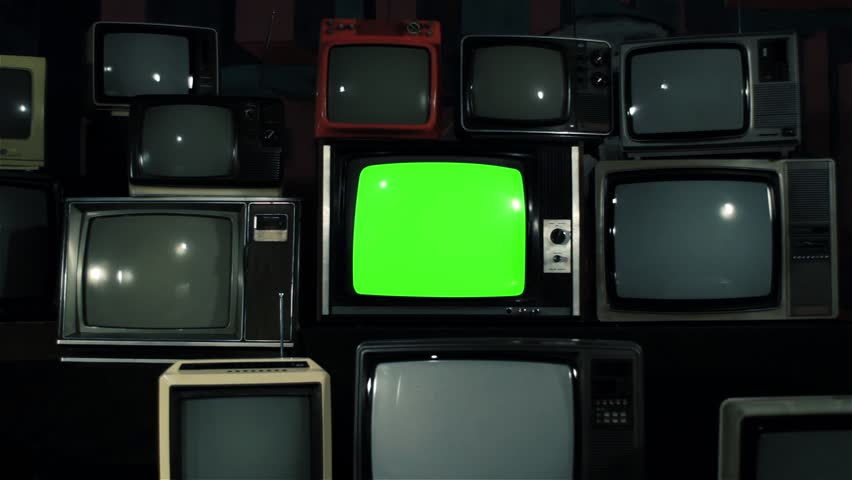 "Old TV Green Screen over 80s TVs. Dolly In. Iron Tone. You can Replace Green Screen with the Footage or Picture you Want with ""Keying"" effect in After Effects (check out tutorials on YouTube).  