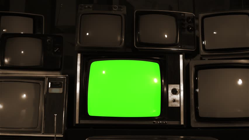 "Retro TV Green Screen over Many TVs. Dolly Out. Sepia Tone. Ready to Replace Green Screen With any Footage or Picture you Want. You Can Do it With ""Keying"" (Chroma Key) Effect. 