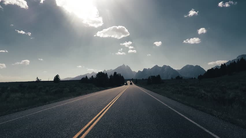 Driving a Car towards Grand Teton, back light, Point of View - Mounted 2.7k Ultra HD footage | Shutterstock HD Video #1019721025