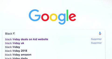 """Paris, France - March 20, 2018: Google Search Engine Search For Words """"Black Friday"""" In Google's Search Bar. Google.com Homepage. Close Up View Of A Computer Monitor Screen - DCi 4K Resolution"""