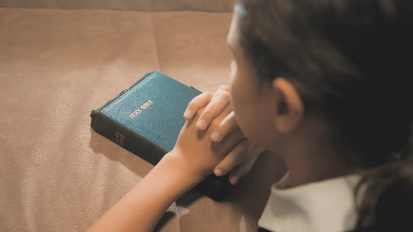 Little girl teenager praying in the night. Little girl hand praying. little girl holy bible prays with bible in her hands. the catholicism sacred holy bible. children and religion upbringing faith | Shutterstock HD Video #1019747965