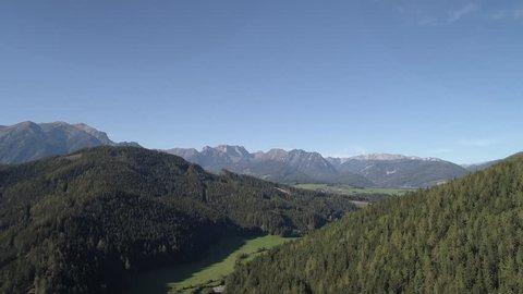 Austria Mountains Aerial Farming Community village and Pine Trees