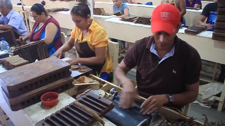 ESTELI, NICARAGUA - APRIL 21, 2016: Workers rolling cigars at Tabacalera Santiago cigar factory in Esteli.