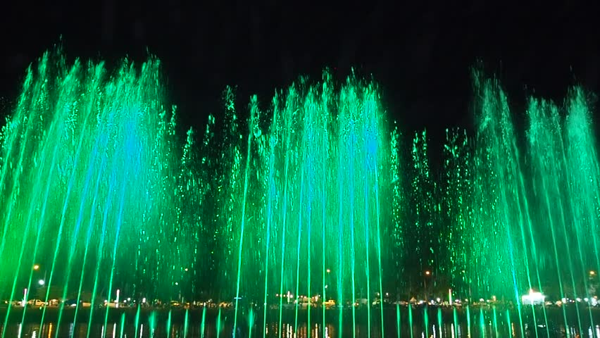 Lopburi, Thailand - November 22,2018: The colorful of fountain at night,  Large multi colored decorative dancing water jet led light fountain show at night. The festival Loykratong. | Shutterstock HD Video #1019894245