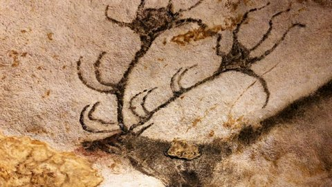 Early human cave painting of a Rain deer with amazing antlers. Beautiful