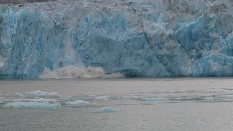 Slow motion calving of the melting Sawyer glacier in Tracy Arm, Alaska 4K