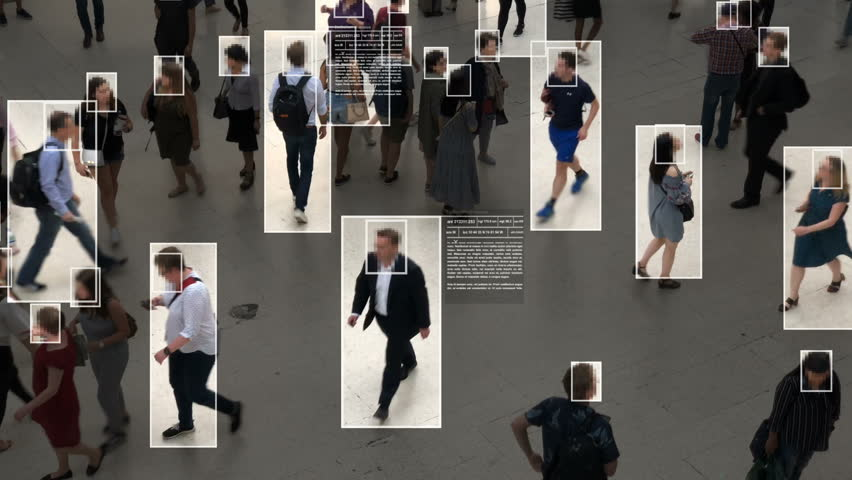 High view of commuters walking. Facial recognition interface showing personal data for each person. Surveillance concept. Artificial intelligence. Deep learning. | Shutterstock HD Video #1020030865