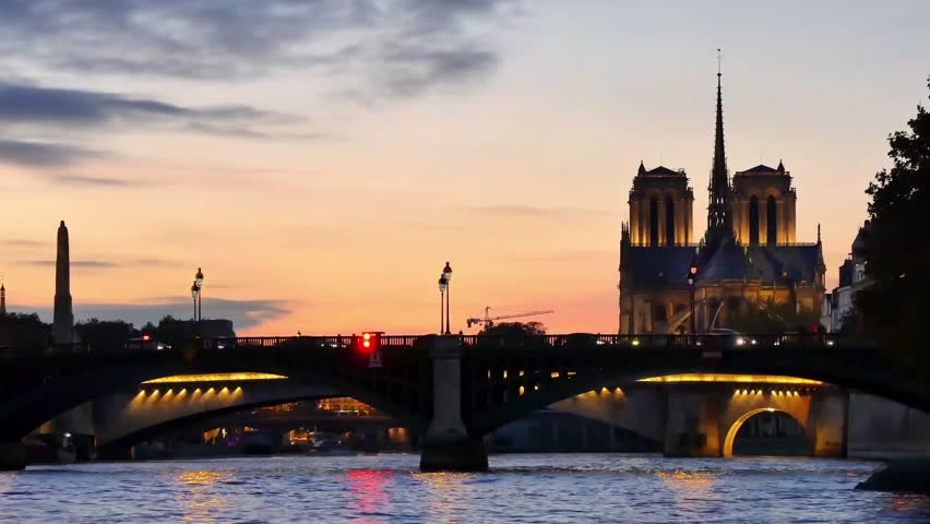 Cinemagraph of Paris. Water is moving. Filmed in Paris in the evening. The city lights are turning on and off. Cinemagraphs are still photographs in which a minor and repeated movement occurs. | Shutterstock HD Video #1020074395