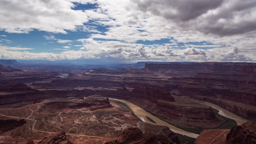 Time lapse of clouds casting shadows over Colorado River & canyons, Dead Horse Point State Park