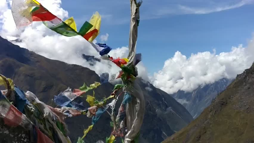 Slow motion video of Prayer Flags on the top of a hill | Shutterstock HD Video #1020139255