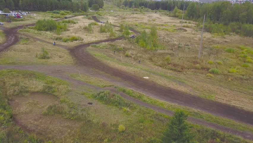 Top view of SUVs driving on country road. Clip. Off-road race on rural forested area on dirty ground | Shutterstock HD Video #1020140695