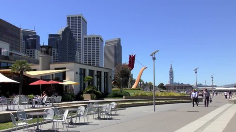 Park along the Embarcadero with Cupids Span (by Claes Oldenburg and Coosje van Bruggen) sculpture, San Francisco, California, USA, 2017
