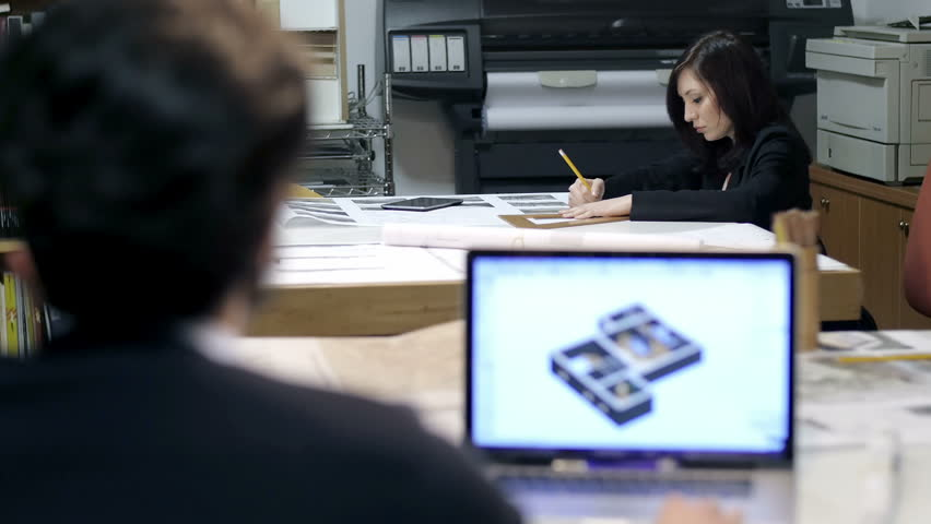 Architect studio male and female architect at work cad software architect studio male and female architect at work cad software blueprint 4k malvernweather Images