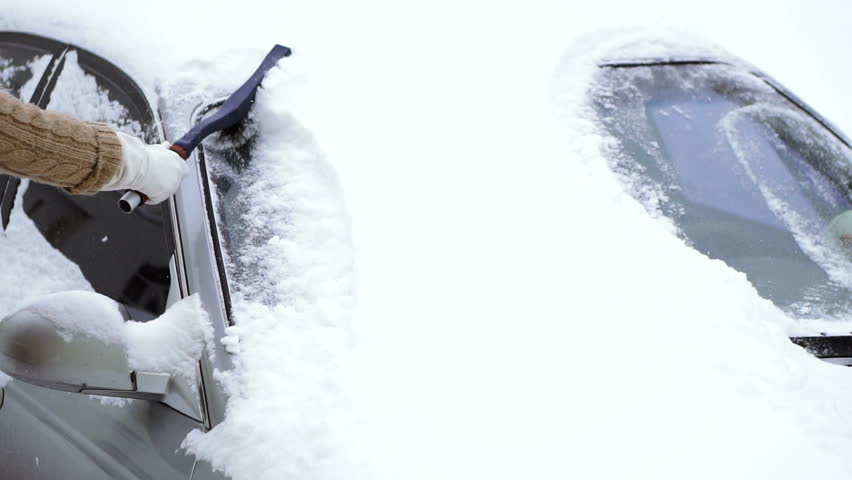 Winter. Cleaning the car from the snow | Shutterstock HD Video #1020383575