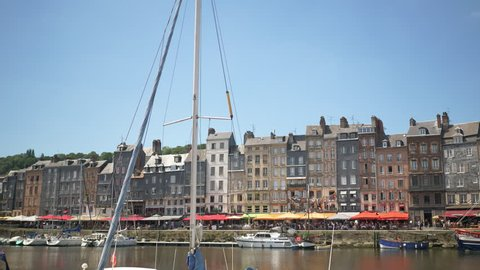 HONFLEUR, FRANCE - JUNE 2018: Panoramic view of the Honfleur harbour old port with beautiful houses. Honfleur is located in the northern region of Calvados, Normandy, France.