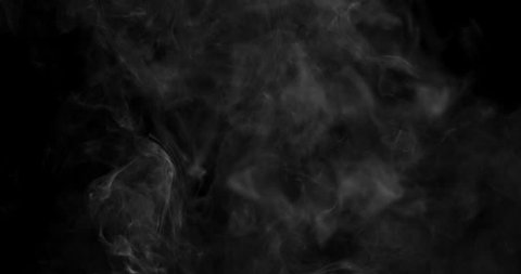 Swirling white cloud of smoke or vapor rising in slow motion against a black background