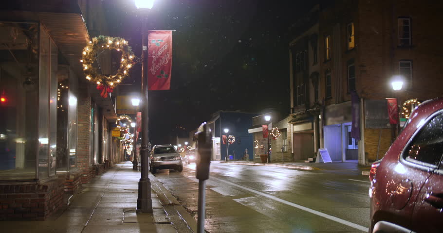 A nighttime view of traffic passing businesses on a typical American main street during Christmas. Pittsburgh suburbs.  	 | Shutterstock HD Video #1020589165