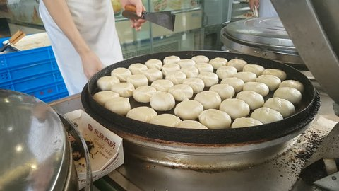 SUZHOU, CHINA - SEPTEMBER 2018: Cooks prepare mooncakes at bakery during popular Mid-Autumn festival in China