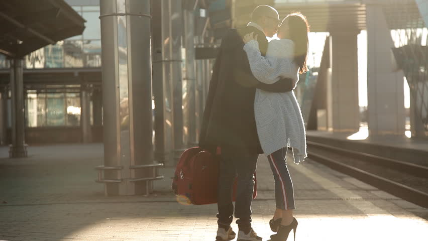 Romantic couple kissing and hugging in train station before separation | Shutterstock HD Video #1020649465