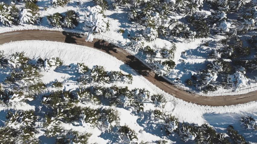 Aerial snow road view of the mountain. sakli kent antalya. winter sports  | Shutterstock HD Video #1020653485