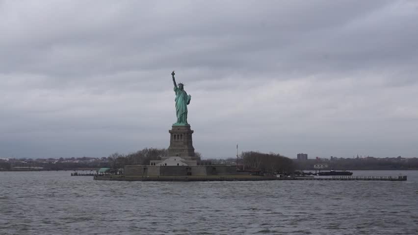 New York, USA - November, 2018: Liberty Island from Staten Island Ferry. View of Statue of Liberty  | Shutterstock HD Video #1020688885