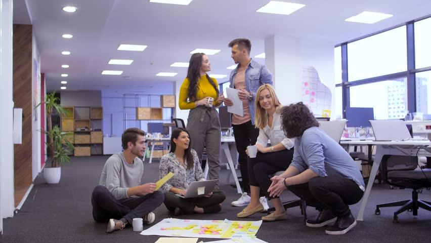Startup business people group discussing about their project. Tech office, tech company, tech startup, tech team. | Shutterstock HD Video #1020717595