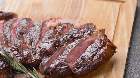 Cooking concept. Grilled marinated beef flank steak on wooden board