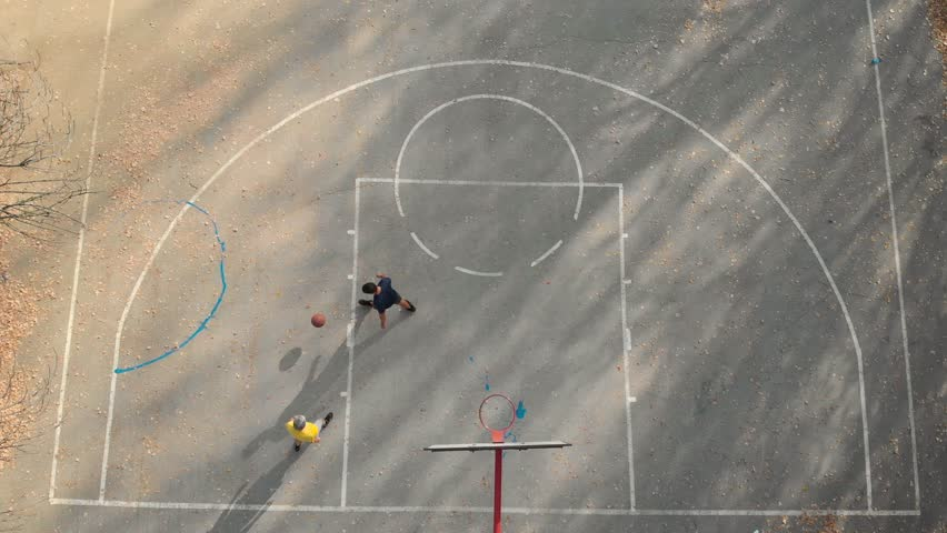 Father and son playing basketball in the park aerial view | Shutterstock HD Video #1020754975