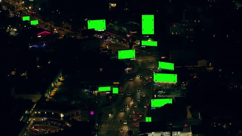 Aerial view of city traffic and billboards on a clear night in Los Angeles, California. Shot on 4K RED camera with green screens
