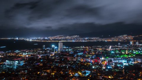 Cityscape at night. Izmir Time Lapse. Clouds motion over city lights.