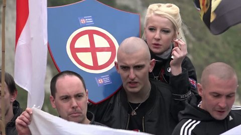 Dover, United Kingdom (UK) - 04 02 2016: Nazi skinheads hold a white power symbol plaque