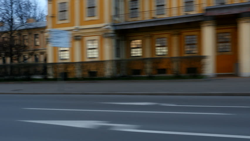 Driving plate side Left, apartments, parked cars, unidentifiable pedestrians. Car moves at the street of S-Petersburg city in historical part of city | Shutterstock HD Video #1020858445