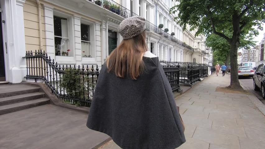 Young fashion woman portrait walking in Notting Hill district. London, UK.   Shutterstock HD Video #1020892105