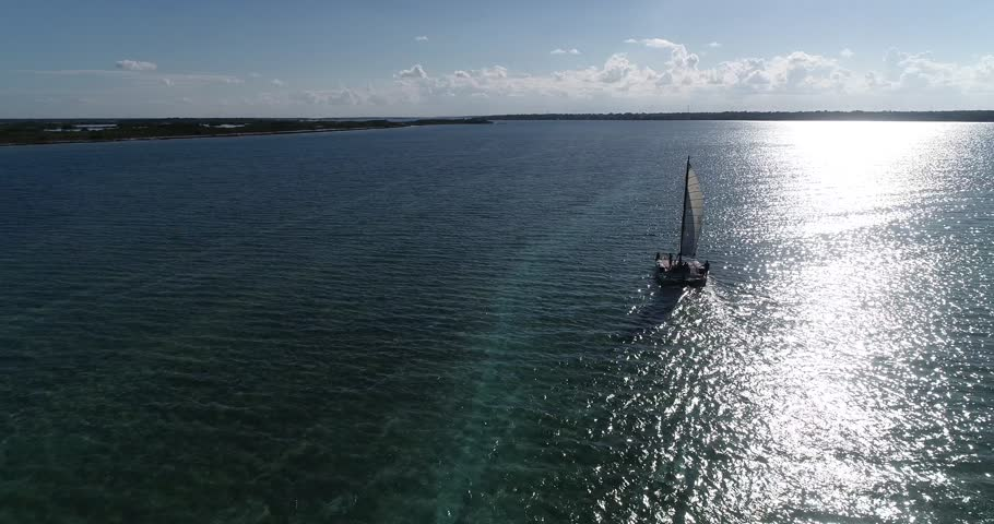Catamaran sailing in Bacalar lagoon | Shutterstock HD Video #1020893875