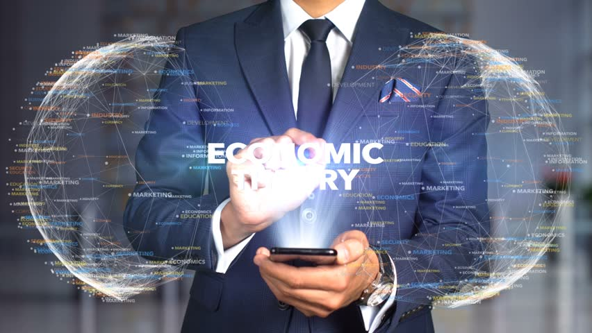 Businessman Hologram Concept Economics - Economic theory   Shutterstock HD Video #1020896005