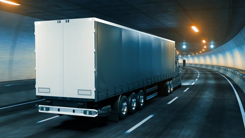 Trailer truck rides through tunnel warm yellow light 3d rendering | Shutterstock HD Video #1020915145