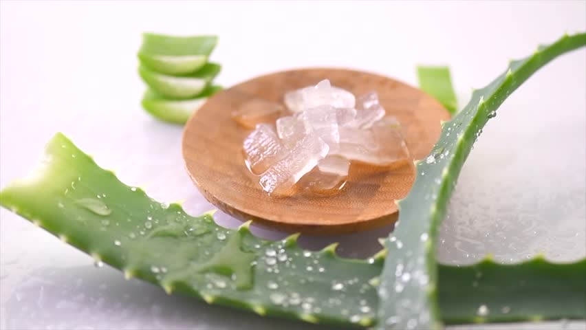 Aloe Vera gel closeup. Sliced Aloevera and gel, natural organic renewal cosmetics, alternative medicine. Skin care concept. Rotation On white background. 4K UHD video. Slow motion   Shutterstock HD Video #1020974215