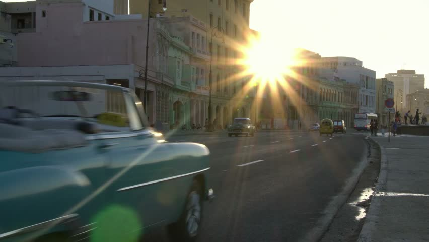 Iconic classic 1950's American vintage convertible car driving on waterfront malecon street in old Havana, Cuba. Cuba travel. | Shutterstock HD Video #1021009675
