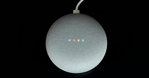 Paris, France - December 17 2018: Overhead View Of A Google Home Mini With Cable (Chalk Color), Black Background. Smart Speaker With The Google Assistant, Virtual Assistant - DCI 4K