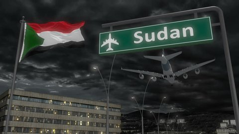 Sudan, approach of the aircraft to land at night in cloudy weather, flying over the name of the country and its flag
