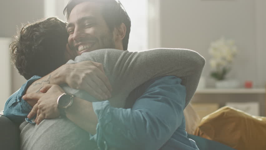 Gay Marriage Proposal Concept. Adorable Boyfriend Gifts a Beautiful Shiny Wedding Ring to His Cute Hispanic Fiance. Surprised Partner is Extremelly Happy and Hugs His Queer Friend. Relationship Goals. | Shutterstock HD Video #1021264495