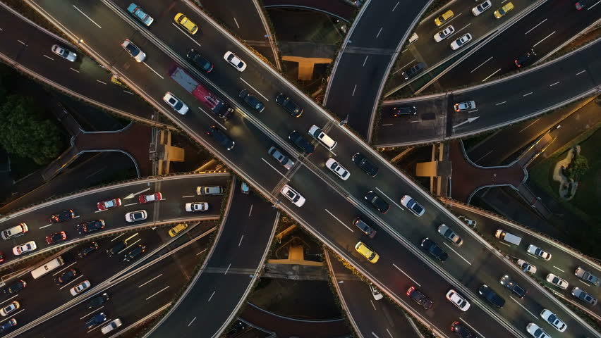 Abstract low angle drone shot of traffic driving over a busy intersection, a convergence of roads in central Shanghai city, China #1021274995