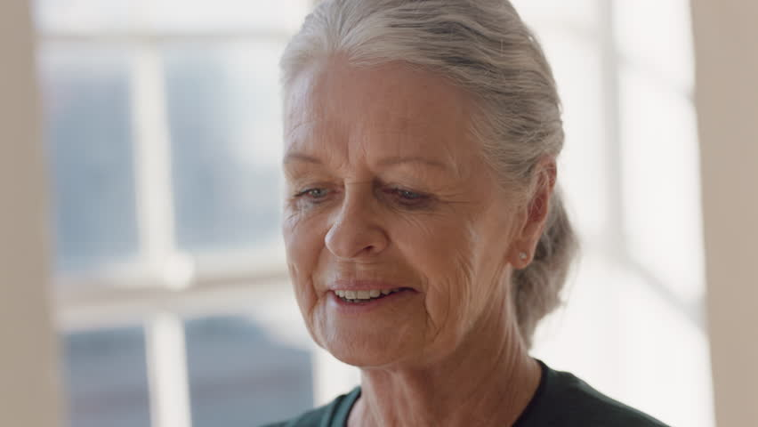 Close up portrait beautiful old woman using smartphone in yoga class sharing healthy lifestyle on social media enjoying browsing meditation practices online in fitness studio | Shutterstock HD Video #1021313725