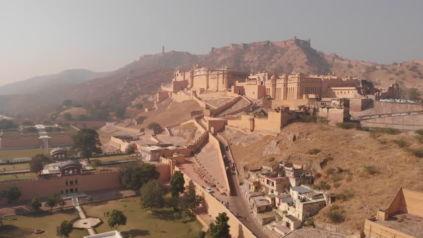 Aerial panoramic view of Amber (Amer) Palace/Fort in historical city of Amer, UNESCO World Heritage Site - near Jaipur (Pink City), Rajasthan, landscape panorama of Northern India, Asia from above | Shutterstock HD Video #1021394785