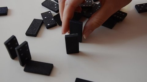 playing domino. domino effect. align of dominos.