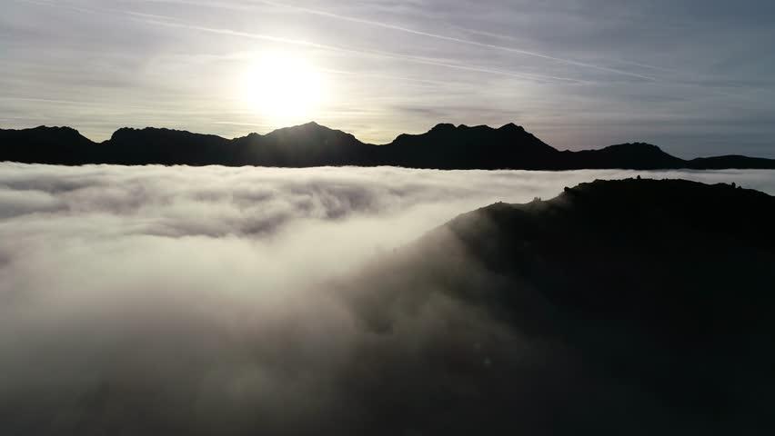 Aerial View Of Fog in Picos de Europa Valley, Spain   Shutterstock HD Video #1021432705